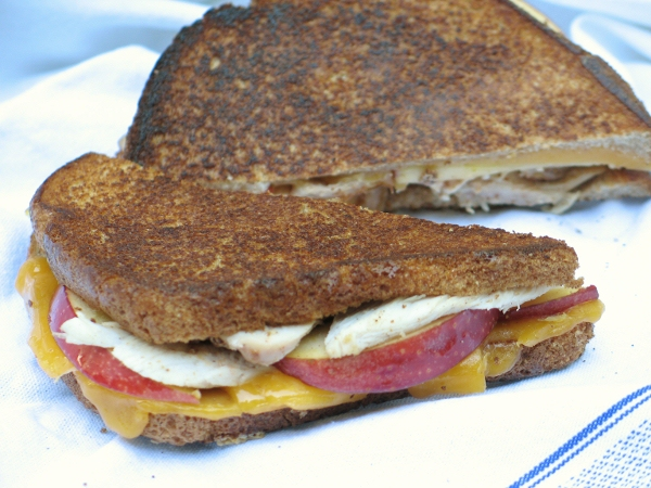 Crisp apple slices contrast beautifully with the melted cheddar and ...