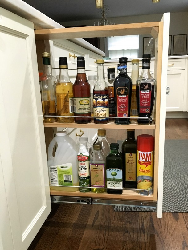 Pull-out spice cabinet with oils and vinegars