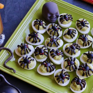 "Green Spider Eggs (aka Avocado Deviled Eggs with Olive ""Spiders"")"